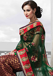Make your collection more attractive and charming with this impressive dress. This maroon art silk lehenga is nicely embroidered patch work is done with resham, zari, sequins, stone and lace work. The beautiful embroidery on lehenga made it awesome and gives you stylish and attractive look to others. Matching choli and dark green net dupatta is availble with this lehenga. Slight Color variations are possible due to differing screen and photograph resolutions.