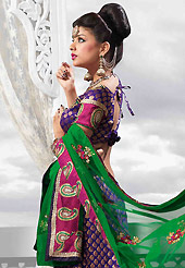 An occasion wear perfect is ready to rock you. This purple art silk lehenga is nicely embroidered patch work is done with resham, zari, sequins, stone and lace work. The beautiful embroidery on lehenga made it awesome and gives you stylish and attractive look to others. Matching choli and green net dupatta is availble with this lehenga. Slight Color variations are possible due to differing screen and photograph resolutions.