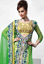 Outfit is a novel ways of getting yourself noticed. This light cream and green net jacket style lehenga is nicely embroidered patch work is done with resham, zari, sequins, stone, beads and lace work. The beautiful embroidery on lehenga made it awesome and gives you stylish and attractive look to others. Contrasting yellow art silk choli, green jacket and green net dupatta is availble with this lehenga. Slight Color variations are possible due to differing screen and photograph resolutions.