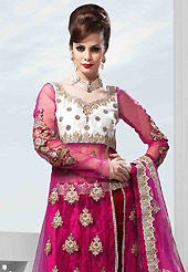 Dreamy variation on shape and forms compliment your style with tradition. This dark magenta velvet lehenga is nicely embroidered patch work is done with resham, zari, sequins, stone, cutdana, kundan and lace work. The beautiful embroidery on lehenga made it awesome and gives you stylish and attractive look to others. Designer net long choli with off white color raw silk yoke part and matching net dupatta is availble with this lehenga. Slight Color variations are possible due to differing screen and photograph resolutions.