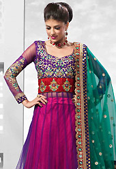 Embroidered lehengas are highly in order on a range of occasions such as wedding, formal party and festivals. This red and purple net lehenga is nicely embroidered patch work is done with resham, zari, sequins, stone, kundana and lace work. The beautiful embroidery on lehenga made it awesome and gives you stylish and attractive look to others. Amazing purple color net long choli with fabulous work yoke part and teal green net dupatta is availble with this lehenga. Slight Color variations are possible due to differing screen and photograph resolutions.