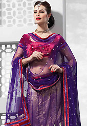 The evolution of style species collection spells pure femininity. This purple net lehenga is nicely embroidered and velvet patch on border work is done with resham, zari, sequins and stone work. The beautiful embroidery on lehenga made it awesome and gives you stylish and attractive look to others. Contrasting red velvet choli and dark purple net dupatta is availble with this lehenga. Slight Color variations are possible due to differing screen and photograph resolutions.