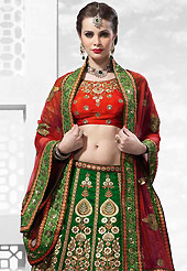 Get ready to sizzle all around you by sparkling lehenga. This dark green and red raw silk lehenga is nicely embroidered patch work is done with resham, zari, sequins, stone, kasab, beads and lace work. The beautiful embroidery on lehenga made it awesome and gives you stylish and attractive look to others. Contrasting red art silk choli and red net dupatta is availble with this lehenga. Slight Color variations are possible due to differing screen and photograph resolutions.