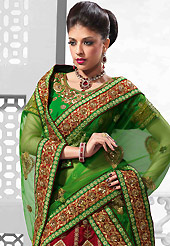 It's cool and has a very modern look to impress all. This red and green raw silk lehenga is nicely embroidered patch work is done with resham, zari, sequins, stone, kasab, beads and lace work. The beautiful embroidery on lehenga made it awesome and gives you stylish and attractive look to others. Contrasting green art silk choli and green net dupatta is availble with this lehenga. Slight Color variations are possible due to differing screen and photograph resolutions.