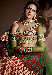 Get ready to sizzle all around you by sparkling lehenga. This maroon net lehenga is nicely embroidered patch work is done with resham, zari, sequins, stone and lace work. The beautiful embroidery on lehenga made it awesome and gives you stylish and attractive look to others. Contrasting red and green choli and green net dupatta is availble with this lehenga. Slight Color variations are possible due to differing screen and photograph resolutions.