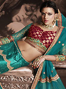 It's cool and has a very modern look to impress all. This turquoise green net lehenga is nicely embroidered patch work is done with resham, zari, sequins, stone and lace work. The beautiful embroidery on lehenga made it awesome and gives you stylish and attractive look to others. Contrasting maroon and turquoise green choli and turquoise green net dupatta is availble with this lehenga. Slight Color variations are possible due to differing screen and photograph resolutions.
