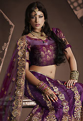 Take a look on the changing fashion of the season. This dark purple net lehenga is nicely embroidered patch work is done with resham, zari, sequins, stone and lace work. The beautiful embroidery on lehenga made it awesome and gives you stylish and attractive look to others. Matching choli and dupatta is availble with this lehenga. Slight Color variations are possible due to differing screen and photograph resolutions.