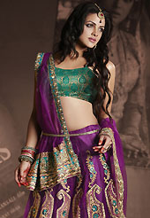 Welcome to the new era of Indian fashion wear. This purple net lehenga is nicely embroidered patch work is done with resham, zari, sequins, stone and lace work. The beautiful embroidery on lehenga made it awesome and gives you stylish and attractive look to others. Contrasting brown choli and purple net dupatta is availble with this lehenga. Slight Color variations are possible due to differing screen and photograph resolutions.