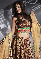 Today's fashion is really about sensuality which can be seen in this creation. This maroon net and viscose lehenga is nicely embroidered patch work is done with resham, zari, sequins, stone and lace work. The beautiful embroidery on lehenga made it awesome and gives you stylish and attractive look to others. Matching choli and light fawn net dupatta is availble with this lehenga. Slight Color variations are possible due to differing screen and photograph resolutions.