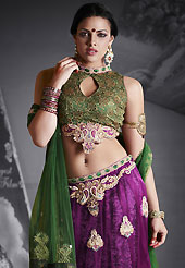 Dreamy variation on shape and forms compliment your style with tradition. This dark purple net lehenga is nicely embroidered patch work is done with resham, zari, sequins, stone, pearls and lace work. The beautiful embroidery on lehenga made it awesome and gives you stylish and attractive look to others. Contrasting green choli and green net dupatta is availble with this lehenga. Slight Color variations are possible due to differing screen and photograph resolutions.