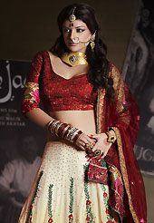 Be the cynosure of all eyes with this wonderful casual wear in flattering colors and combinations. This shaded cream georgette lehenga is nicely embroidered patch work is done with resham, zari, sequins, stone and lace work. The beautiful embroidery on lehenga made it awesome and gives you stylish and attractive look to others. Contrasting dark red choli and dark red net dupatta is availble with this lehenga. Slight Color variations are possible due to differing screen and photograph resolutions.