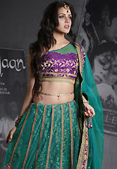 Outfit is a novel ways of getting yourself noticed. This teal green net lehenga is nicely embroidered patch work is done with resham, zari, sequins, stone and lace work. The beautiful embroidery on lehenga made it awesome and gives you stylish and attractive look to others. Contrasting purple choli and teal green net dupatta is availble with this lehenga. Slight Color variations are possible due to differing screen and photograph resolutions.
