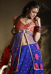 Embroidered lehengas are highly in order on a range of occasions such as wedding, formal party and festivals. This dark blue lehenga is nicely embroidered patch work is done with resham, zari, sequins, stone and lace work. The beautiful embroidery on lehenga made it awesome and gives you stylish and attractive look to others. Contrasting dark red and blue long choli and dark red net dupatta is availble with this lehenga. Slight Color variations are possible due to differing screen and photograph resolutions.
