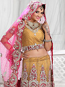 Get ready to sizzle all around you by sparkling lehenga. This light brown net lehenga is nicely embroidered and velvet patch work is done with stone, zardosi, cutdana and cutbeads work. The beautiful embroidery on lehenga made it awesome and gives you stylish and attractive look to others. Matching choli and pink net dupatta is availble with this lehenga. Slight Color variations are possible due to differing screen and photograph resolutions.