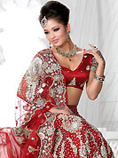 No one like ordinary look, because every woman has their own beauty and our collection gives extra ordinary look to you. This red net lehenga is nicely embroidered and velvet patch work is done with stone, zardosi, cutdana and cutbeads work. The beautiful embroidery on lehenga made it awesome and gives you stylish and attractive look to others. Matching choli and dupatta is availble with this lehenga. Slight Color variations are possible due to differing screen and photograph resolutions.