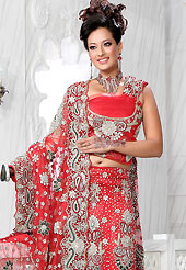 Elegance and innovation of designs crafted for you. This red net lehenga is nicely embroidered and velvet patch work is done with stone, zardosi, cutdana and cutbeads work. The beautiful embroidery on lehenga made it awesome and gives you stylish and attractive look to others. Matching choli and dupatta is availble with this lehenga. Slight Color variations are possible due to differing screen and photograph resolutions.