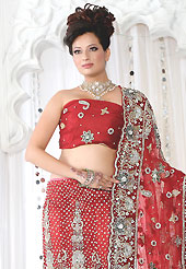 Make your collection more attractive and charming with this impressive dress. This red net lehenga is nicely embroidered and velvet patch work is done with stone, zardosi, cutdana and cutbeads work. The beautiful embroidery on lehenga made it awesome and gives you stylish and attractive look to others. Matching choli and dupatta is availble with this lehenga. Slight Color variations are possible due to differing screen and photograph resolutions.