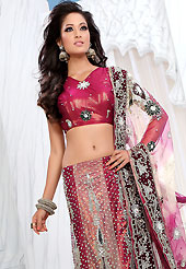 Outfit is a novel ways of getting yourself noticed. This deep pink and beige net lehenga is nicely embroidered and velvet patch work is done with stone, zardosi, cutdana and cutbeads work. The beautiful embroidery on lehenga made it awesome and gives you stylish and attractive look to others. Matching choli and shaded net dupatta is availble with this lehenga. Slight Color variations are possible due to differing screen and photograph resolutions.