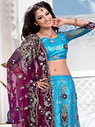 Make your collection more attractive and charming with this impressive dress. This blue net lehenga is nicely embroidered and velvet patch work is done with stone, zardosi, cutdana and cutbeads work. The beautiful embroidery on lehenga made it awesome and gives you stylish and attractive look to others. Matching choli and burgundy net dupatta is availble with this lehenga. Slight Color variations are possible due to differing screen and photograph resolutions.