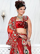 Today's fashion is really about sensuality which can be seen in this creation. This red net lehenga is nicely embroidered and velvet patch work is done with stone, zardosi, cutdana and cutbeads work. The beautiful embroidery on lehenga made it awesome and gives you stylish and attractive look to others. Matching choli and dupatta is availble with this lehenga. Slight Color variations are possible due to differing screen and photograph resolutions.
