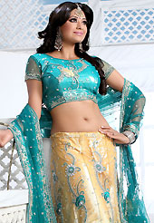 Get ready to sizzle all around you by sparkling lehenga. This dark cream and teal blue net lehenga is nicely embroidered patch work is done with stone, zardosi, cutdana and cutbeads work. The beautiful embroidery on lehenga made it awesome and gives you stylish and attractive look to others. Matching choli and dupatta is availble with this lehenga. Slight Color variations are possible due to differing screen and photograph resolutions.