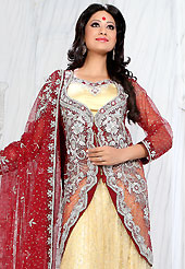 Let your personality speak for you this wedding lehenga embellished with embroidery work. This cream net lehenga is nicely embroidered patch work is done with stone, zardosi, cutdana and cutbeads work. The beautiful embroidery on lehenga made it awesome and gives you stylish and attractive look to others. Matching cream choli, heavy work red net jacket and red net dupatta is availble with this lehenga. Slight Color variations are possible due to differing screen and photograph resolutions.