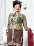 Elegance and innovation of designs crafted for you. This maroon net lehenga is nicely embroidered patch work is done with stone, zardosi, cutdana and cutbeads work. The beautiful embroidery on lehenga made it awesome and gives you stylish and attractive look to others. Contrasting green choli, heavy work green net jacket and maroon net dupatta is availble with this lehenga. Slight Color variations are possible due to differing screen and photograph resolutions.