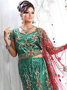 Outfit is a novel ways of getting yourself noticed. This green net lehenga is nicely embroidered patch work is done with stone, zardosi, cutdana and cutbeads work. The beautiful embroidery on lehenga made it awesome and gives you stylish and attractive look to others. Matching choli and red net dupatta is availble with this lehenga. Slight Color variations are possible due to differing screen and photograph resolutions.