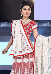 Outfit is a novel ways of getting yourself noticed. This off white and red net lehenga is nicely embroidered patch work is done with resham, stone and lace work. The beautiful embroidery on lehenga made it awesome and gives you stylish and attractive look to others. Matching red choli and off white dupatta is availble with this lehenga. Slight Color variations are possible due to differing screen and photograph resolutions.