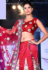 Dreamy variation on shape and forms compliment your style with tradition. This dark red net and brocade lehenga is nicely embroidered patch work is done with resham, zari, sequins, stone, lace and latken work. The beautiful embroidery on lehenga made it awesome and gives you stylish and attractive look to others. Matching choli and dupatta is availble with this lehenga. Slight Color variations are possible due to differing screen and photograph resolutions.