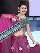 Be the cynosure of all eyes with this wonderful casual wear in flattering colors and combinations. This dark pink net lehenga is nicely embroidered patch work is done with resham, zari, sequins, stone and lace work. The beautiful embroidery on lehenga made it awesome and gives you stylish and attractive look to others. Contrasting green choli and dark pink net dupatta is availble with this lehenga. Slight Color variations are possible due to differing screen and photograph resolutions.