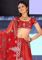 Outfit is a novel ways of getting yourself noticed. This red net lehenga is nicely embroidered patch work is done with resham, zari, sequins, stone and lace work. The beautiful embroidery on lehenga made it awesome and gives you stylish and attractive look to others. Matching choli and dupatta is availble with this lehenga. Slight Color variations are possible due to differing screen and photograph resolutions.