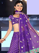 The evolution of style species collection spells pure femininity. This purple net and brocade lehenga is nicely embroidered patch work is done with resham, zari, sequins, stone and lace work. The beautiful embroidery on lehenga made it awesome and gives you stylish and attractive look to others. Matching choli and dupatta is availble with this lehenga. Slight Color variations are possible due to differing screen and photograph resolutions.