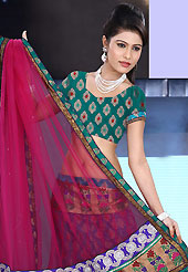 It's cool and has a very modern look to impress all. This hot pink and teal green net and brocade lehenga is nicely embroidered patch work is done with resham, zari, sequins, stone and lace work. The beautiful embroidery on lehenga made it awesome and gives you stylish and attractive look to others. Matching teal green choli and hot pink net dupatta is availble with this lehenga. Slight Color variations are possible due to differing screen and photograph resolutions.