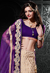 Elegance and innovation of designs crafted for you. This light fawn brocade lehenga choli is nicely embroidered and velvet patch border is done with resham, zari, sequins, stone and lace work. The beautiful embroidery on lehenga made it awesome and gives you stylish and attractive look to others. Contrasting purple choli and purple net dupatta is availble with this lehenga. Slight Color variations are possible due to differing screen and photograph resolutions.