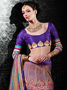 Get ready to sizzle all around you by sparkling lehenga. This fawn and dark pink net a-line lehenga choli is nicely embroidered patch border is done with resham, zari, sequins, stone and lace work. The beautiful embroidery on lehenga made it awesome and gives you stylish and attractive look to others. Contrasting purple art silk choli and fawn net dupatta is availble with this lehenga. Slight Color variations are possible due to differing screen and photograph resolutions.