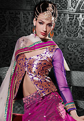 It's cool and has a very modern look to impress all. This magenta net a-line lehenga choli is nicely embroidered patch border is done with zari, stone and lace work. The beautiful embroidery on lehenga made it awesome and gives you stylish and attractive look to others. Contrasting purple brocade and net choli and off white net dupatta is availble with this lehenga. Slight Color variations are possible due to differing screen and photograph resolutions.