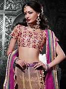 Ultimate collection of embroidered lehengas with fabulous style. This shaded mustard net a-line lehenga choli is nicely embroidered patch border is done with resham, zari, stone and lace work. The beautiful embroidery on lehenga made it awesome and gives you stylish and attractive look to others. Contrasting magenta art silk choli and magenta net dupatta is availble with this lehenga. Slight Color variations are possible due to differing screen and photograph resolutions.