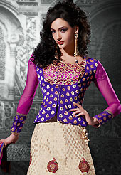 An occasion wear perfect is ready to rock you. This light fawn viscose jacquard a-line lehenga choli is nicely embroidered patch border is done with resham, zari, stone and lace work. The beautiful embroidery on lehenga made it awesome and gives you stylish and attractive look to others. Contrasting blue and magenta choli and magenta net dupatta is availble with this lehenga. Slight Color variations are possible due to differing screen and photograph resolutions.