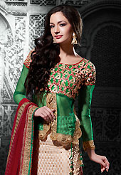 Take the fashion industry by storm in this beautiful embroidered lehengas. This beige viscose jacquard a-line lehenga choli is nicely embroidered patch border is done with resham, zari, stone and lace work. The beautiful embroidery on lehenga made it awesome and gives you stylish and attractive look to others. Contrasting green dupion and net choli and maroon net dupatta is availble with this lehenga. Slight Color variations are possible due to differing screen and photograph resolutions.
