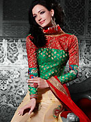 The traditional patterns used on this lehenga maintain the ethnic look. This light fawn net a-line lehenga choli is nicely embroidered patch border is done with resham, zari, stone and lace work. The beautiful embroidery on lehenga made it awesome and gives you stylish and attractive look to others. Contrasting green and red brocade choli and red net dupatta is availble with this lehenga. Slight Color variations are possible due to differing screen and photograph resolutions.
