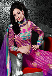 Make your collection more attractive and charming with this impressive dress. This magenta and purple net a-line lehenga choli is nicely embroidered patch border is done with resham, zari, stone and lace work. The beautiful embroidery on lehenga made it awesome and gives you stylish and attractive look to others. Matching magenta and purple brocade choli and purple net dupatta is availble with this lehenga. Slight Color variations are possible due to differing screen and photograph resolutions.