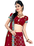 Outfit is a novel ways of getting yourself noticed. This dark red faux georgette lehenga is nicely embroidered patch work is done with resham, zari, sequins and stone work. The beautiful embroidery on lehenga made it awesome and gives you stylish and attractive look to others. Matching choli and dupatta is availble with this lehenga. Slight Color variations are possible due to differing screen and photograph resolutions.