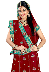 Welcome to the new era of Indian fashion wear. This dark red faux georgette lehenga is nicely embroidered patch work is done with resham, zari, sequins and stone work. The beautiful embroidery on lehenga made it awesome and gives you stylish and attractive look to others. Matching choli and dupatta is availble with this lehenga. Slight Color variations are possible due to differing screen and photograph resolutions.