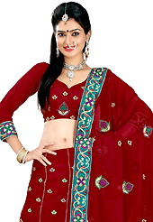 Be the cynosure of all eyes with this wonderful casual wear in flattering colors and combinations. This dark red faux georgette lehenga is nicely embroidered patch work is done with resham, zari, sequins and stone work. The beautiful embroidery on lehenga made it awesome and gives you stylish and attractive look to others. Matching choli and dupatta is availble with this lehenga. Slight Color variations are possible due to differing screen and photograph resolutions.