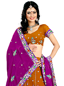 Get ready to sizzle all around you by sparkling lehenga. This rust faux georgette lehenga is nicely embroidered patch work is done with resham, zari, sequins and stone work. The beautiful embroidery on lehenga made it awesome and gives you stylish and attractive look to others. Matching choli and purple dupatta is availble with this lehenga. Slight Color variations are possible due to differing screen and photograph resolutions.
