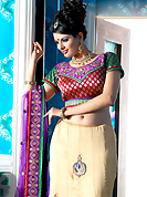 Get ready to sizzle all around you by sparkling lehenga. This cream crepe a-line lehenga choli is nicely embroidered patch border is done with resham, zari, sequins, stone and lace work. The beautiful embroidery on lehenga made it awesome and gives you stylish and attractive look to others. Contrasting red and green brocade choli and purple net dupatta is availble with this lehenga. Slight Color variations are possible due to differing screen and photograph resolutions.