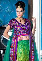 Ultimate collection of embroidered lehengas with fabulous style. This shaded green net a-line lehenga choli is nicely embroidered patch border is done with resham, zari, sequins, stone and lace work. The beautiful embroidery on lehenga made it awesome and gives you stylish and attractive look to others. Contrasting purple choli and turquoise green net dupatta is availble with this lehenga. Slight Color variations are possible due to differing screen and photograph resolutions.