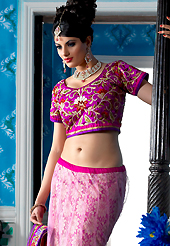 Elegance and innovation of designs crafted for you. This pink net a-line lehenga choli is nicely embroidered patch border is done with resham, zari, sequins, stone and lace work. The beautiful embroidery on lehenga made it awesome and gives you stylish and attractive look to others. Contrasting magenta choli and purple net dupatta is availble with this lehenga. Slight Color variations are possible due to differing screen and photograph resolutions.