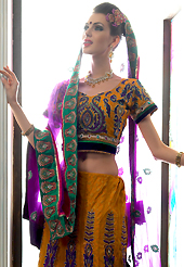 Embroidered lehengas are the best choice for a girl to enhance her feminine look. This rust net a-line lehenga choli is nicely embroidered patch border is done with resham, zari, sequins, stone and lace work. The beautiful embroidery on lehenga made it awesome and gives you stylish and attractive look to others. Matching choli and purple net dupatta is availble with this lehenga. Slight Color variations are possible due to differing screen and photograph resolutions.